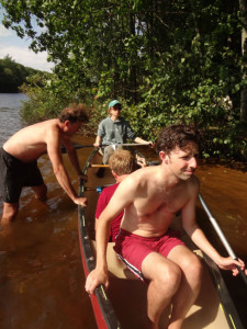 One actor holds the canoe, and two others sit in it... The recordist is just off to the side.